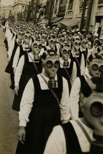 School girls in horrifying gas masks. WWII
